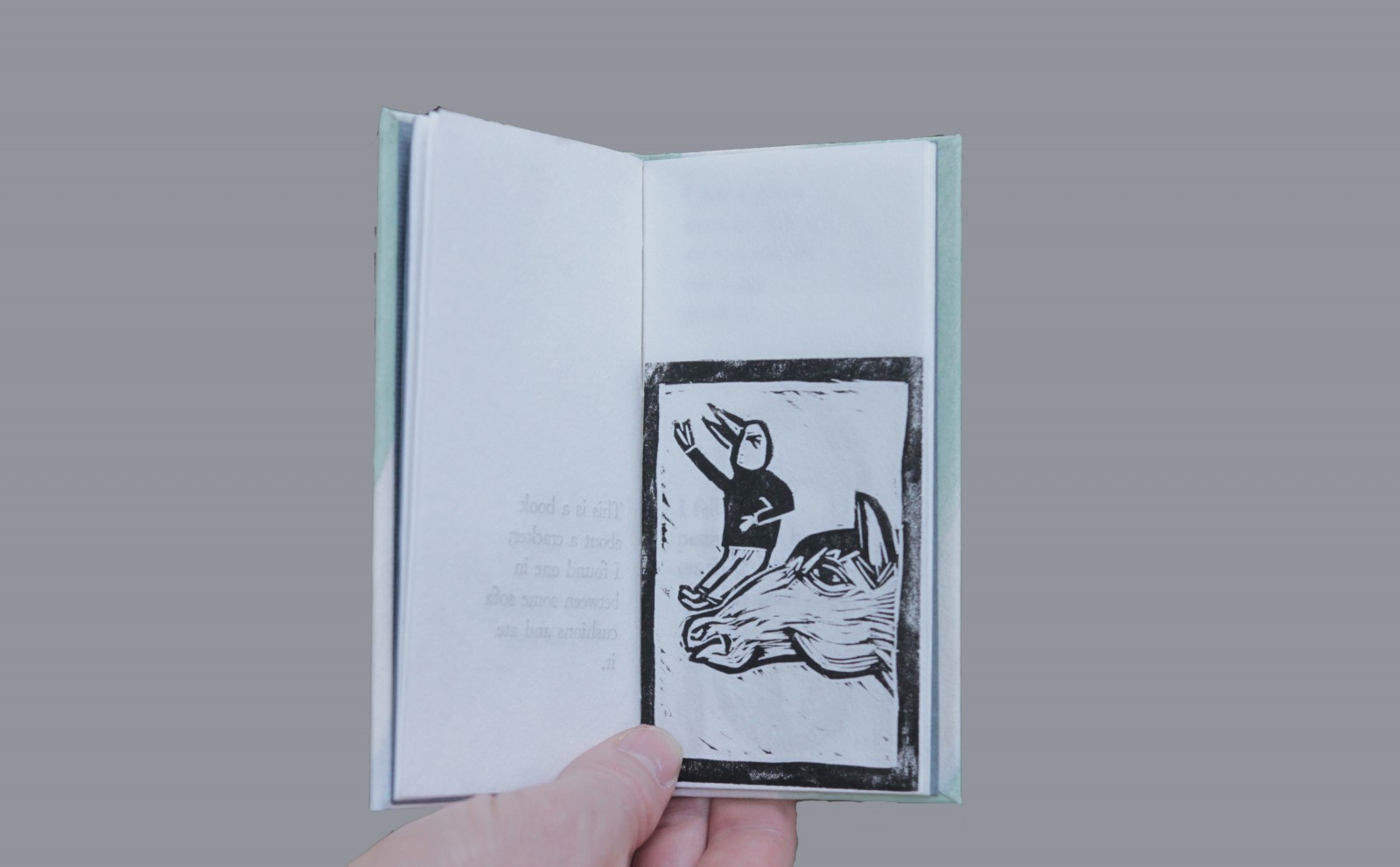 "Letterpress, woodcut and acrylic on Japanese paper. Artist book. 3 x 6"". Edition of six."